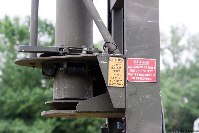 Interesting tower mechanism. Insert section, crank up, clamp, lower platform, insert next section...