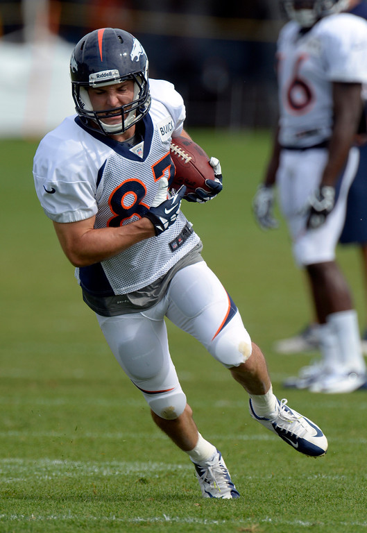 . Denver Broncos WR Wes Welker (83) turns up field after catching a Peyton Manning pass in drills during training camp August 1, 2013 at Dove Valley. (Photo By John Leyba/The Denver Post)