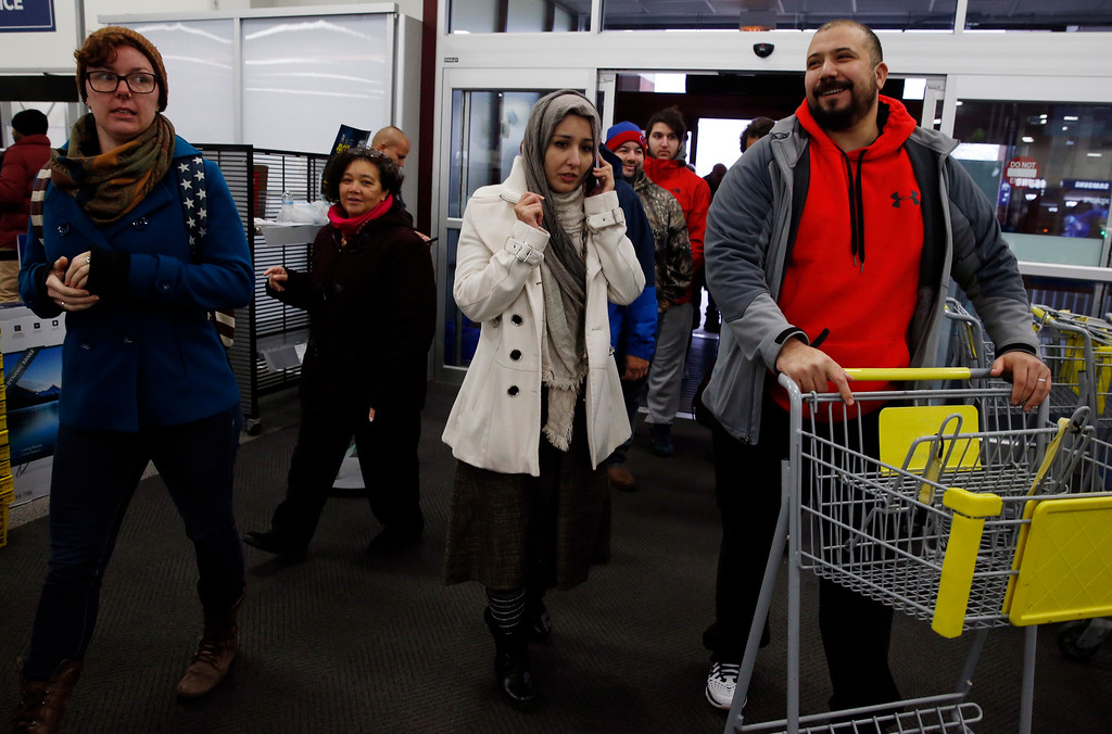 . Shoppers walk into a Best Buy store on Friday, Nov. 25, 2016, in Skokie, Ill. Black Friday, historically the starting line of the retail industry\'s crucial holiday buying season, isn\'t quite the one-day spree it used to be. Some retailers have pushed their biggest Black Friday door-buster deals into Thanksgiving Day and spread other promotions to even earlier in the season. (AP Photo/Nam Y. Huh)