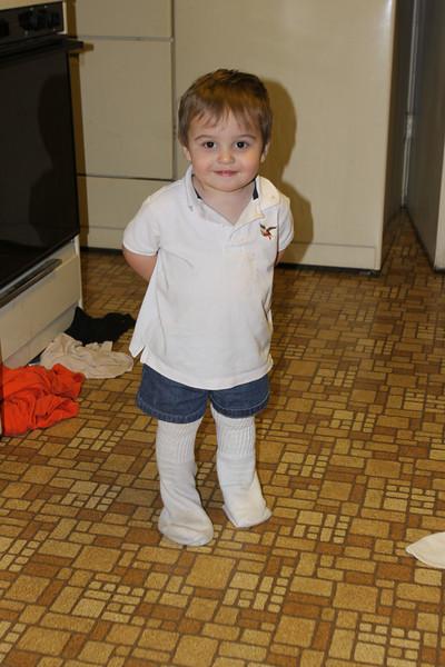 Wearing Daddy's socks!