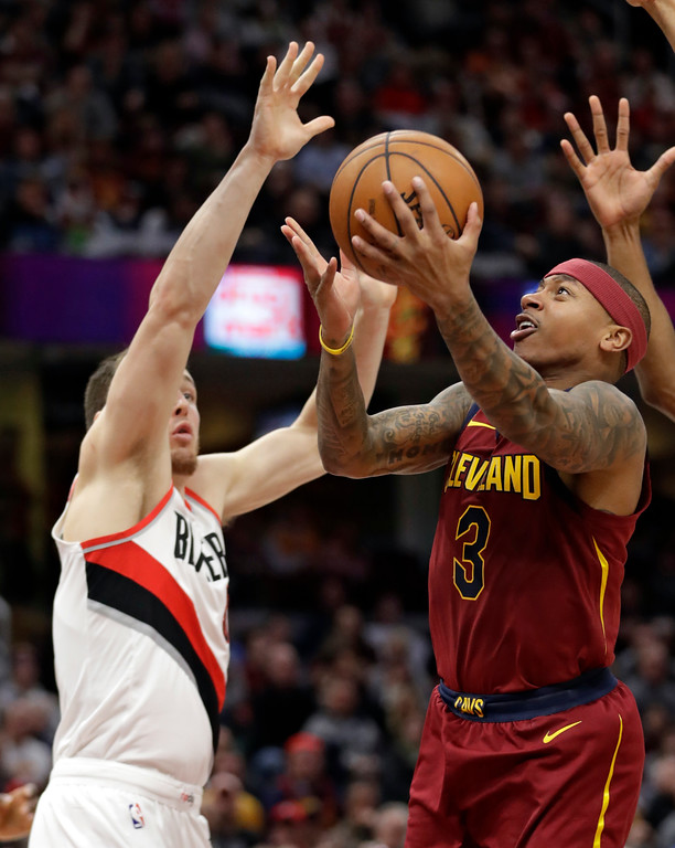 . Cleveland Cavaliers\' Isaiah Thomas (3) drives to the basket against Portland Trail Blazers\' Pat Connaughton (5) in the second half of an NBA basketball game, Tuesday, Jan. 2, 2018, in Cleveland. The Cavaliers won 127-110. (AP Photo/Tony Dejak)