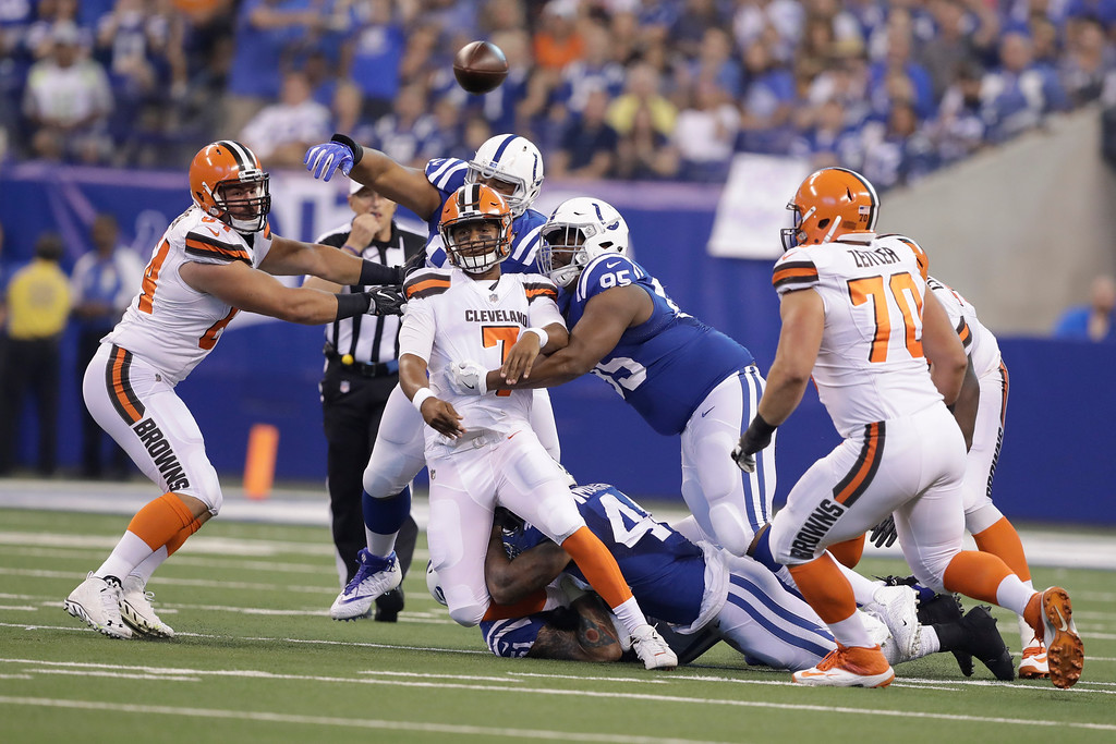 . Cleveland Browns quarterback DeShone Kizer (7) is hit as he throws by Indianapolis Colts defensive end Johnathan Hankins (95) during the first half of an NFL football game in Indianapolis, Sunday, Sept. 24, 2017. (AP Photo/Darron Cummings)