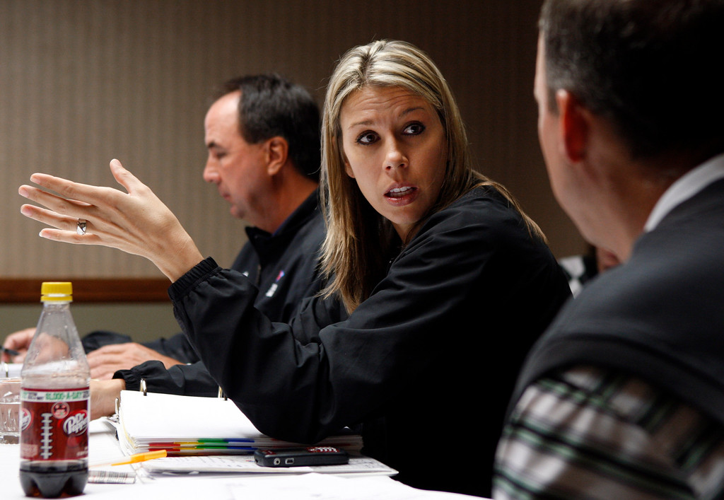 . In this photo made Oct. 27, 2009, Sarah Thomas, center, attends a meeting of her college football officiating crew at a hotel in Memphis, Tenn. Thomas is one of five women officiating Division I college football and is on the NFL\'s list of officiating prospects. (AP Photo/Mark Humphrey)