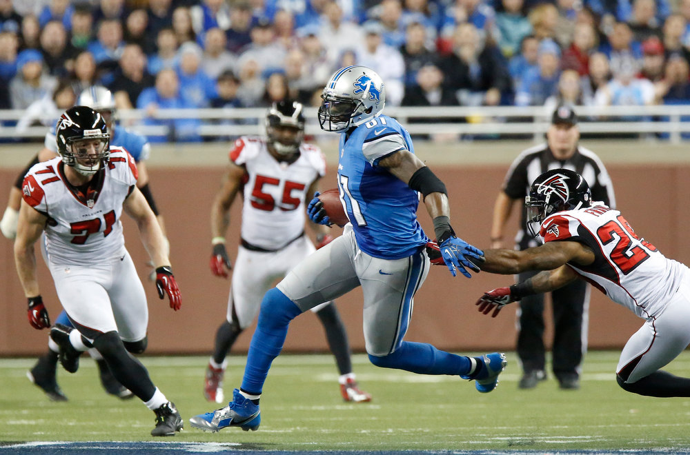 Description of . Detroit Lions wide receiver Calvin Johnson (81) breaks away from Atlanta Falcons defensive back Dominique Franks (29) during the third quarter of an NFL football game at Ford Field in Detroit, Saturday, Dec. 22, 2012. (AP Photo/Duane Burleson)