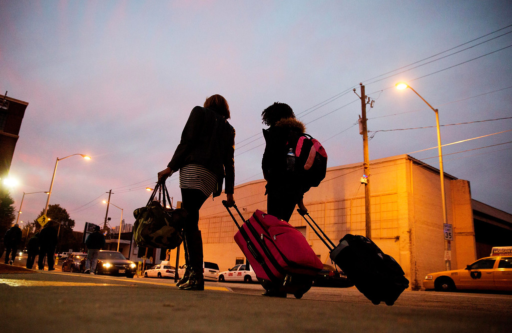 . Travelers pull their luggage as they walk to a Greyhound bus station in Atlanta, Wednesday, Nov. 23, 2016. Almost 49 million people are expected to travel 50 miles or more for the holiday, the most since 2007, according to AAA. (AP Photo/David Goldman)