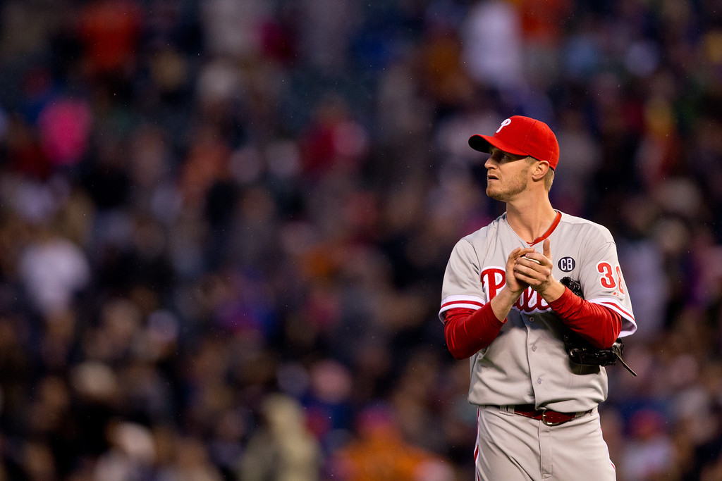 . Starting pitcher Kyle Kendrick #38 of the Philadelphia Phillies looks up at the scoreboard after giving up a home run to Justin Morneau #33 of the Colorado Rockies during the fourth inning at Coors Field on April 19, 2014 in Denver, Colorado.  (Photo by Justin Edmonds/Getty Images)