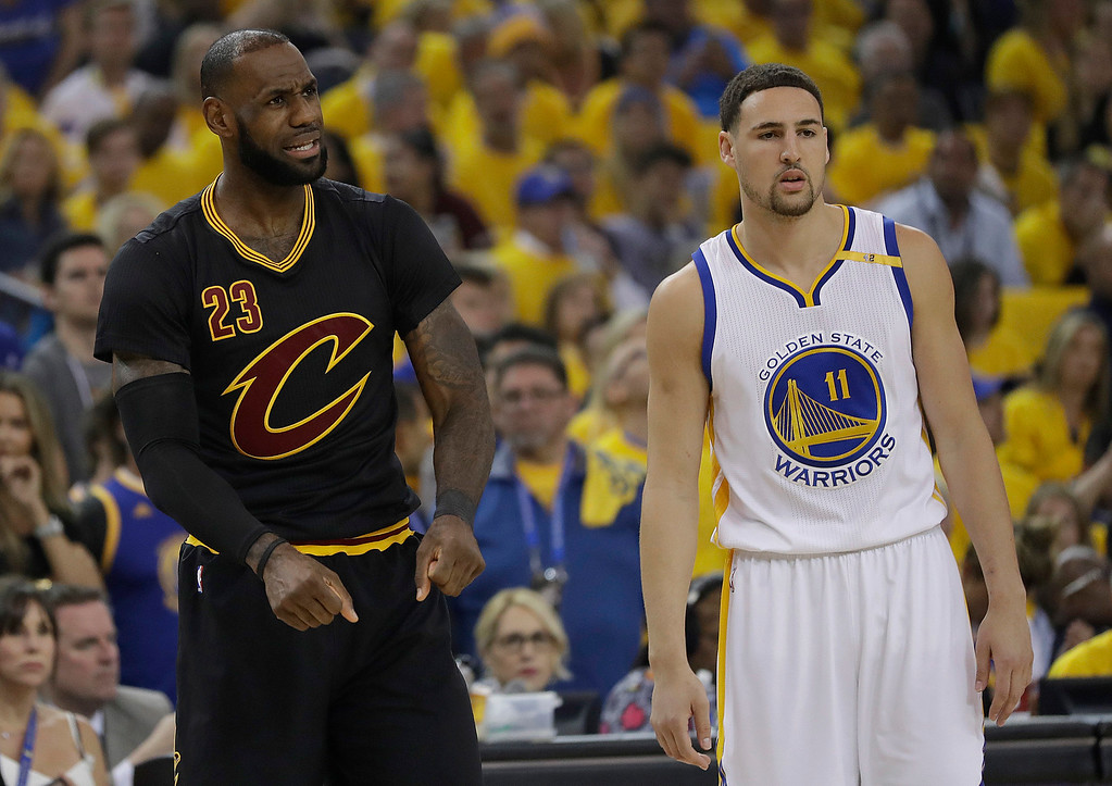 . Cleveland Cavaliers forward LeBron James (23) reacts next to Golden State Warriors guard Klay Thompson (11) during the first half of Game 5 of basketball\'s NBA Finals in Oakland, Calif., Monday, June 12, 2017. (AP Photo/Marcio Jose Sanchez)