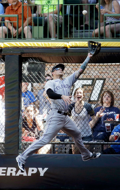 . Colorado Rockies right fielder Brandon Barnes makes a leaping catch on a ball hit by Milwaukee Brewers\' Khris Davis during the fourth inning of a baseball game Sunday, June 29, 2014, in Milwaukee. (AP Photo/Morry Gash)