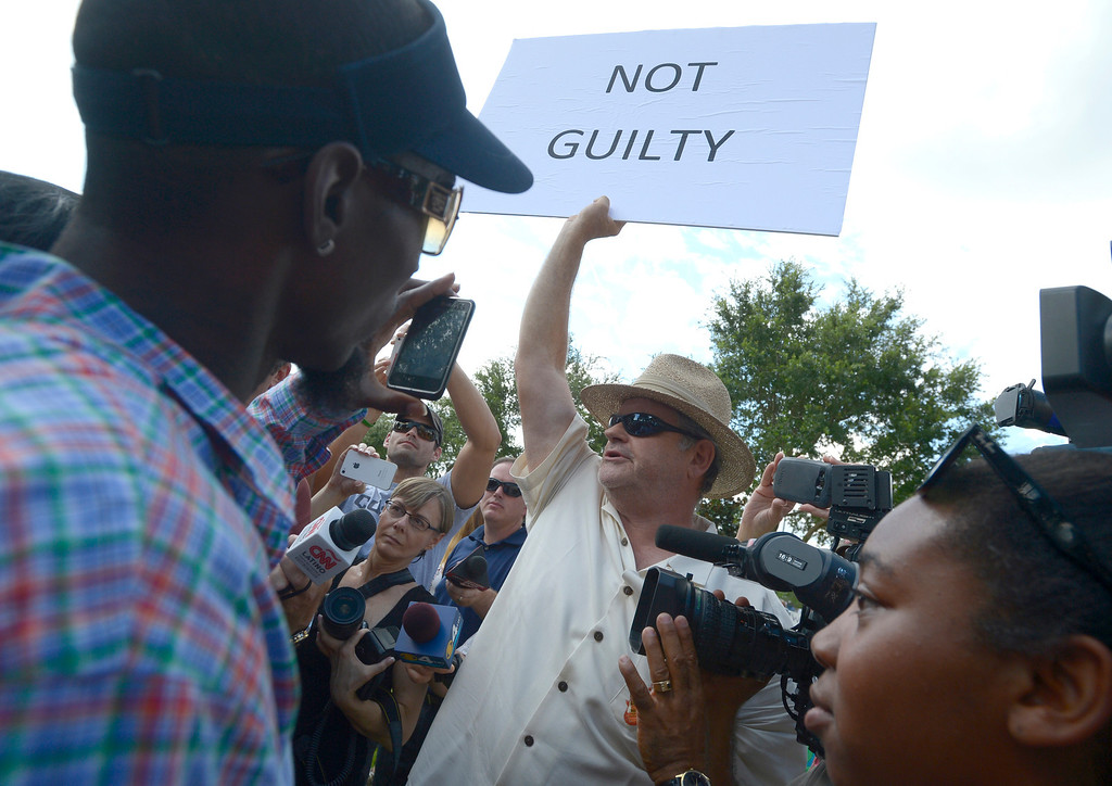 . A man who would not provide his name, shows his support for George Zimmerman outside the Seminole County Courthouse in Sanford, Fla., Saturday, July 13, 2013.  Zimmerman has been charged in the 2012 shooting death of Trayvon Martin.(AP Photo/Phelan M. Ebenhack)