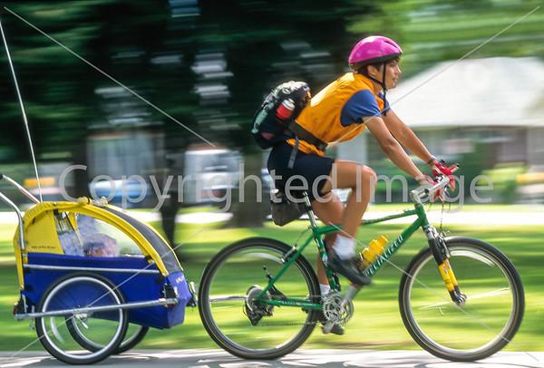 Utah - Salt Lake City - Cyclist & Child Enjoying Park