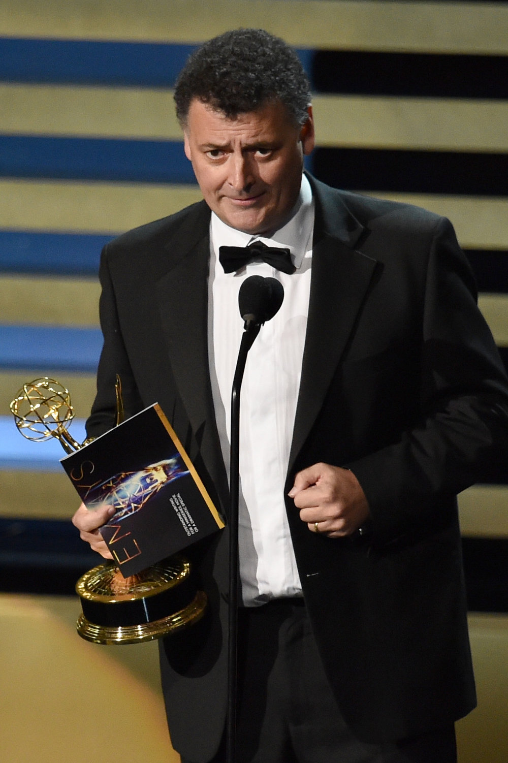 . Writer Steven Moffat accepts Outstanding Writing for a Miniseries, Movie or a Dramatic Special for \'Sherlock: His Last Vow\' onstage at the 66th Annual Primetime Emmy Awards held at Nokia Theatre L.A. Live on August 25, 2014 in Los Angeles, California.  (Photo by Kevin Winter/Getty Images)