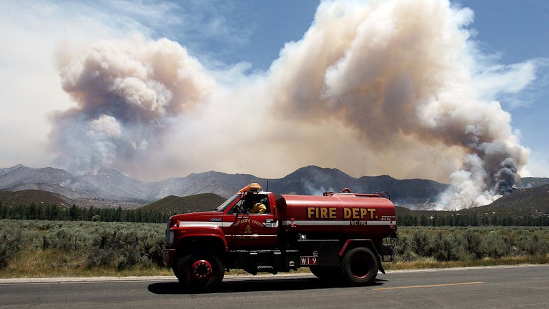 . A water tender makes his way back to the the Mountain Fire near Lake Hemet on Tuesday July 16, 2013. The 14,200 acre forest fire near Idyllwild Calif., has caused Idyllwild and adjacent communities east of Highway 243 to issued mandatory evacuations for hundreds of homes Wednesday. (AP Photo/The Press-Enterprise, Frank Bellino)