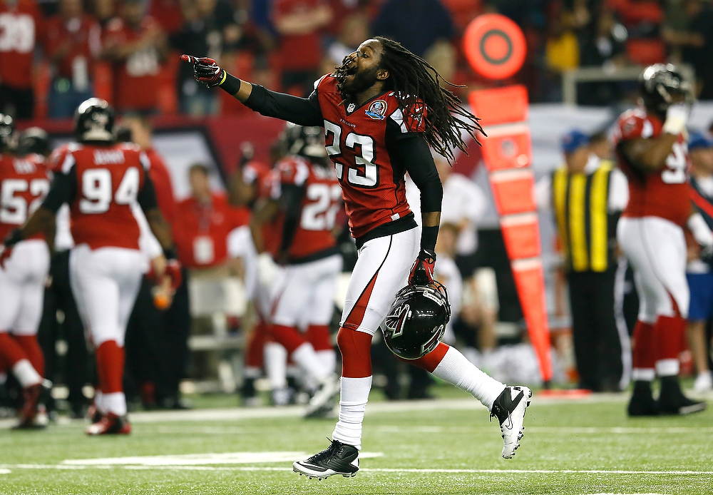 Description of . Dunta Robinson #23 of the Atlanta Falcons celebrates a turnover by the New York Giants at Georgia Dome on December 16, 2012 in Atlanta, Georgia.  (Photo by Kevin C. Cox/Getty Images)