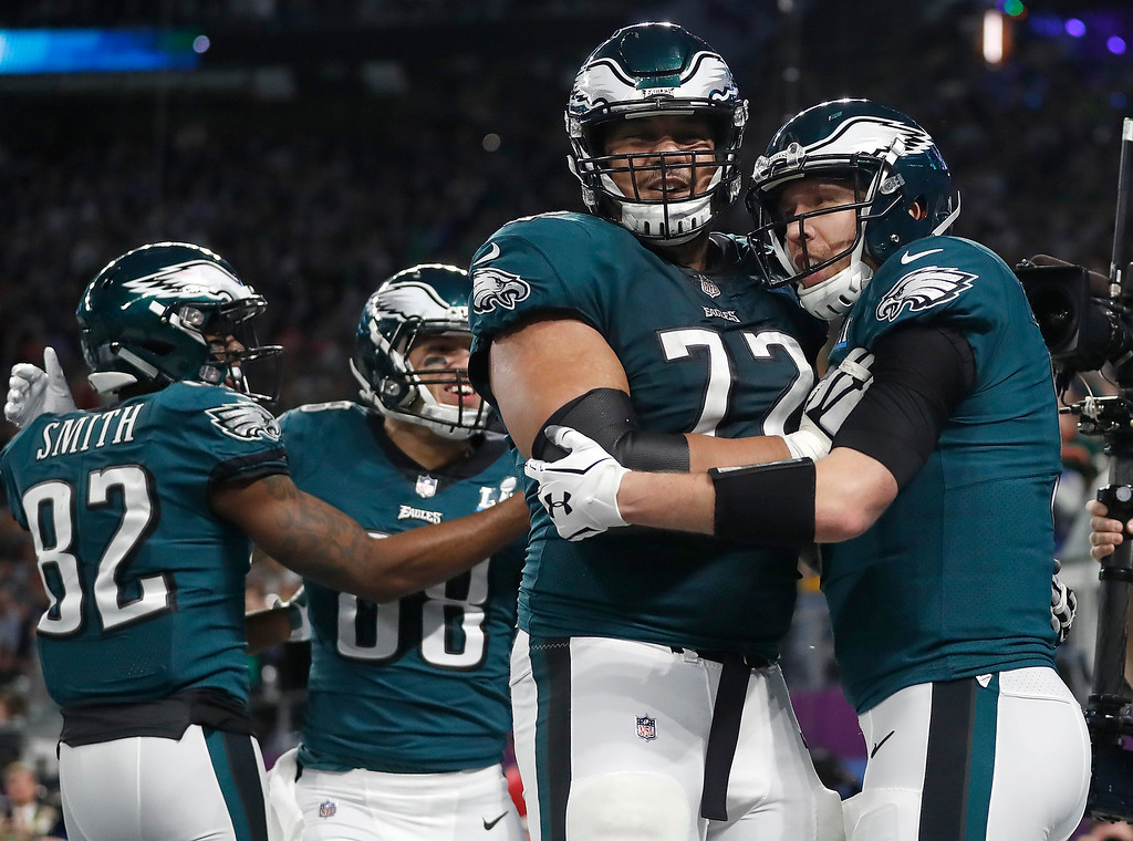 . Philadelphia Eagles quarterback Nick Foles, right, celebrates his touchdown catch with Halapoulivaati Vaitai during the first half of the NFL Super Bowl 52 football game against the New England Patriots Sunday, Feb. 4, 2018, in Minneapolis. (AP Photo/Jeff Roberson)