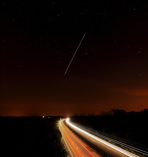 April 22 2011. Super Bright ISS passing over UK skies at 2149-54hrs. Found a great spot to watch as the ISS flew directly over and along the A14 with head/tail light streaks resulting from the long exposure. Captured with Oly E5 & 7-14mm. 5 images @15s stacked.