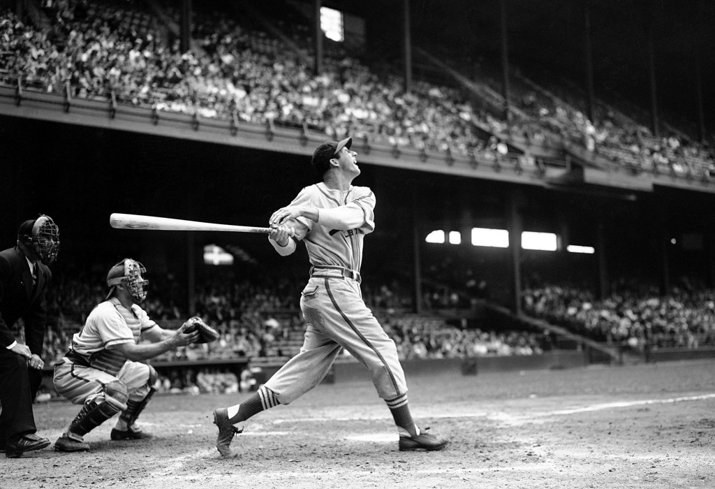 . FILE - In this May 22, 1946 file photo, St. Louis Cardinals\' Stan Musial bats against the Philadelphia Phillies during a baseball game at Shibe Park in Philadelphia, Pa. Musial, one of baseball\'s greatest hitters and a Hall of Famer with the Cardinals for more than two decades, died Saturday, Jan 19, 2013, the team announced. He was 92. (AP Photo/Warren M. Winterbottom, File)
