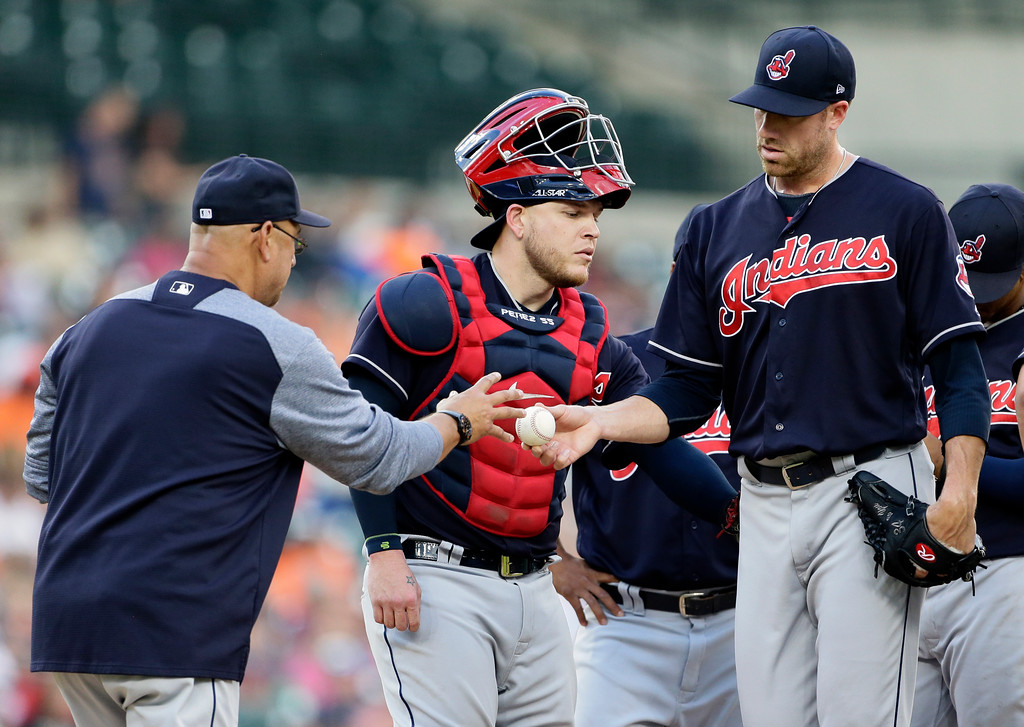 . Cleveland Indians pitcher Zach McAllister is pulled by manager Terry Francona, left, after loading the bases in the seventh inning, as catcher Roberto Perez pats McAllister on the backside during the team\'s baseball game against the Detroit Tigers on Saturday, July 28, 2018, in Detroit. The Tigers defeated the Indians 2-1. (AP Photo/Duane Burleson)