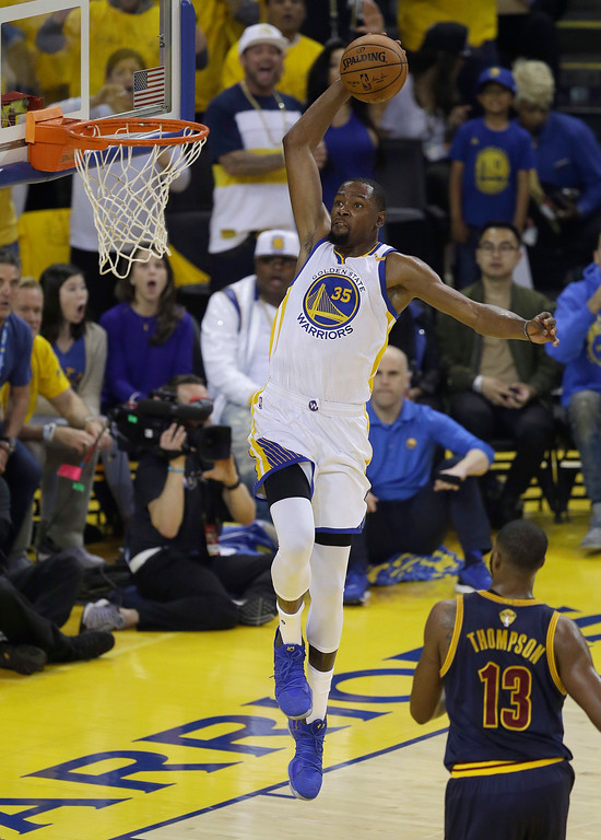 . Golden State Warriors forward Kevin Durant (35) dunks against the Cleveland Cavaliers during the first half of Game 1 of basketball\'s NBA Finals in Oakland, Calif., Thursday, June 1, 2017. (AP Photo/Ben Margot)