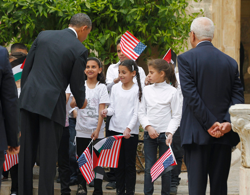 . U.S. President Barack Obama interacts with children as he tours the Church of the Nativity in Bethlehem March 22, 2013.   REUTERS/Jason Reed
