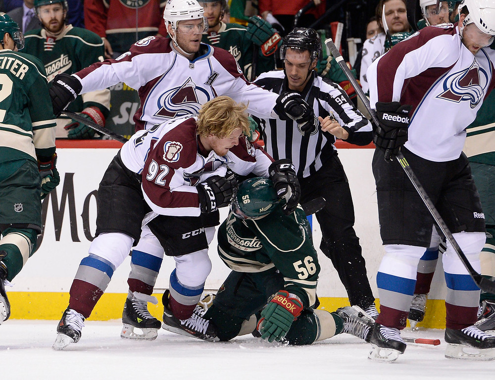 . Colorado Avalanche left wing Gabriel Landeskog (92) pins Minnesota Wild left wing Erik Haula (56) down on the ice during a scuffle in the first period  April 28, 2014 in Game 6 of the Stanley Cup Playoffs at Xcel Energy Center.  (Photo by John Leyba/The Denver Post)
