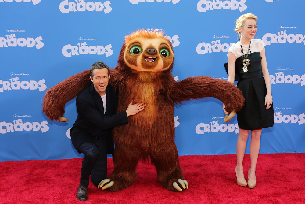 """. Actors Ryan Reynolds and Emma Stone attend \""""The Croods\"""" premiere at AMC Loews Lincoln Square 13 theater on March 10, 2013 in New York City.  (Photo by Neilson Barnard/Getty Images)"""