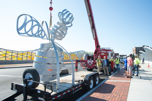 09/03/19 Wesley Bunnell | StaffrrThe final bee statue was hoisted into place onto the Bee Hive Bridge by Sign Pro on Tuesday September 3, 2019. The bee sits on a trailer ready to be lifted.