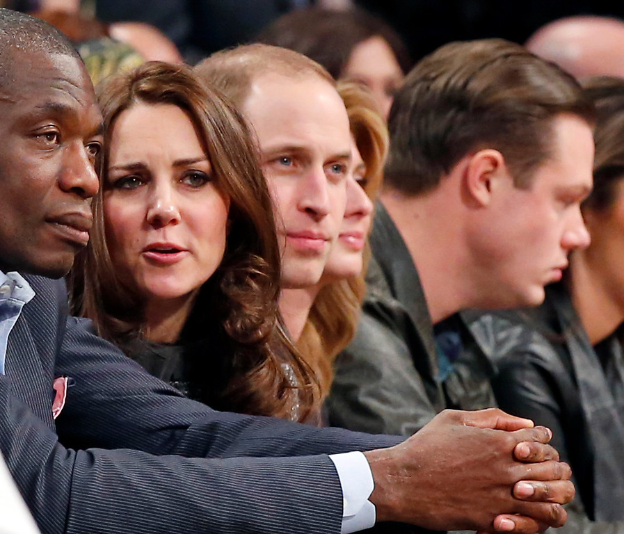 . Former Houston Rockets player Dikembe Mutombo, from left, sits next to Kate, the Duchess of Cambridge, and Britain\'s Prince William, during an NBA basketball game between the Cleveland Cavaliers and the Brooklyn Nets at the Barclays Center in New York, Monday, Dec. 8, 2014. (AP Photo/Kathy Willens)