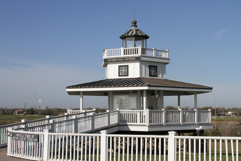 Halfmoon Shoal Lighthouse - A number of families settled along Galveston Bay in the 1830s after land grants were awarded to veterans of the republic of Texas army and navy. An early community at this site became known officially as Shoal Point in 1878 when a U. S. Post Office was established. It was renamed Texas City in 1893. The commencement of shipping in Galveston Bay led to increased settlement in the area. In 1854 the U. S. Government erected a lighthouse in the bay two miles east of Shoal Point at Half Moon Shoal. One of several lighthouses built along the Texas Gulf Coast that year, the Half Moon Shoal lighthouse was a red and white painted frame structure with galleries surrounding the main portion of the building and a captain's walk around the light. A bell served as a fog warning device. Decommissioned during the Civil War, the lighthouse was returned to service in 1868 and provided hazard warnings until the disastrous 1900 storm, when a steamship broke free from its mooring and drifted into the structure, destroying it and killing keeper Charles K. Bowen. A beacon replaced the lighthouse until the shipping lanes in the bay were chanted after the construction of the Texas City channel and dike. From: Historical Marker.