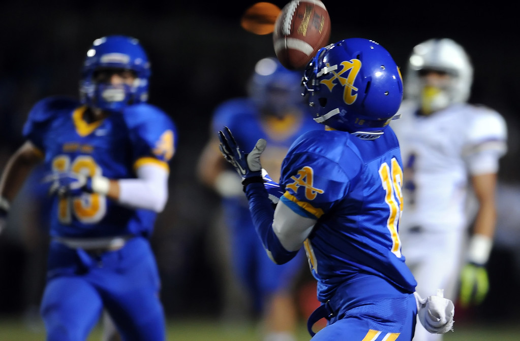 . Bishop Amat\'s Trevon Sidney (18) intercepts a Charter Oak pass in the first half of a prep football game at Bishop Amat High School in La Puente, Calif. on Friday, Sept. 20, 2013.    (Photo by Keith Birmingham/Pasadena Star-News)