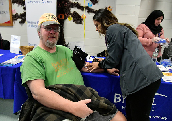 3/9/2019 Mike Orazzi | Staff Terry Skrzypiec has his blood pressure checked by Bristol Hospital's Jelisa Sampson during The Central Connecticut Chambers of Commerce's Family Health & Wellness Expo held Saturday at Bristol Eastern High School.