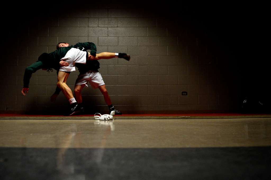 . DENVER, CO - FEBRUARY 21: Niwot 106-pounder Clayton Robinson works a double leg on teammate 132-pounder Joey Lambert during the Colorado State High School Wrestling Championships. The state finals will run through Saturday evening at the Pepsi Center. (Photo by AAron Ontiveroz/The Denver Post)