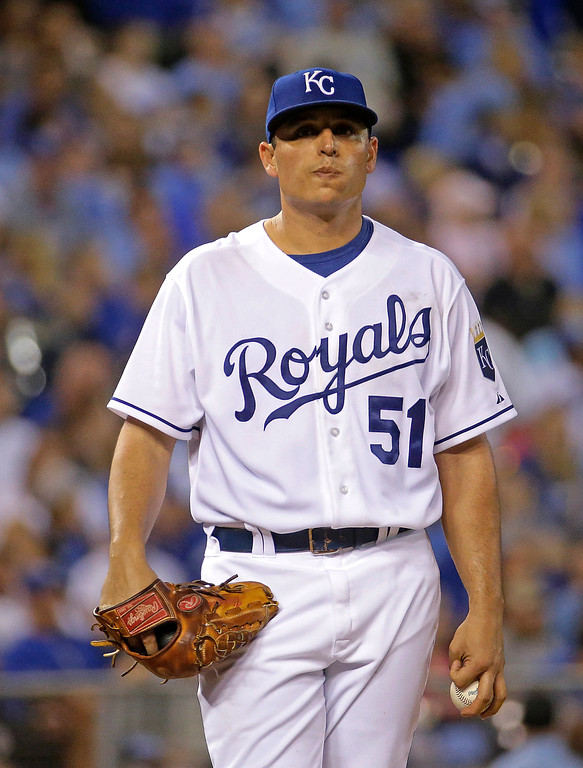 . Kansas City Royals starting pitcher Jason Vargas stands on the mound after allowing a run during the fourth inning of a baseball game against the Detroit Tigers on Friday, Sept. 19, 2014, in Kansas City, Mo. (AP Photo/Charlie Riedel)