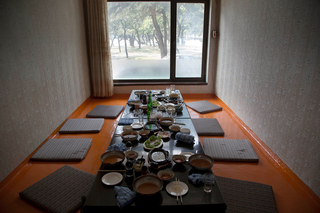 """. In this June 15, 2014 photo, the remains of lunch sits on a restaurant table in the city of Wonsan, North Korea. The Associated Press was granted permission to embark on a weeklong road trip across North Korea to the countryís spiritual summit Mount Paektu. The trip was on North Korea\'s terms. An AP reporter and photographer couldn\'t interview ordinary people or wander off course, and government \""""minders\"""" accompanied them the entire way. (AP Photo/David Guttenfelder)"""