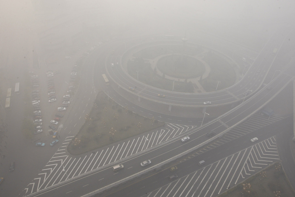 . Streets and cars are seen under heavy smog in Harbin, northeast China\'s Heilongjiang province, on October 21, 2013.     AFP PHOTOSTR/AFP/Getty Images
