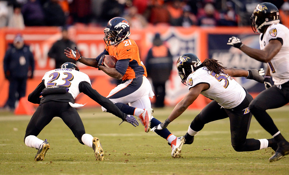 Description of . Denver Broncos running back Ronnie Hillman (21) runs the ball against Baltimore Ravens defensive back Chykie Brown (23) during the third quarter.  The Denver Broncos vs Baltimore Ravens AFC Divisional playoff game at Sports Authority Field Saturday January 12, 2013. (Photo by John Leyba,/The Denver Post)