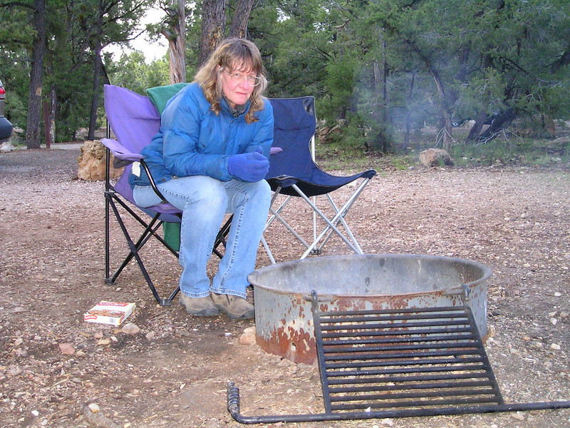Me, huddling by our small, smoky fire.