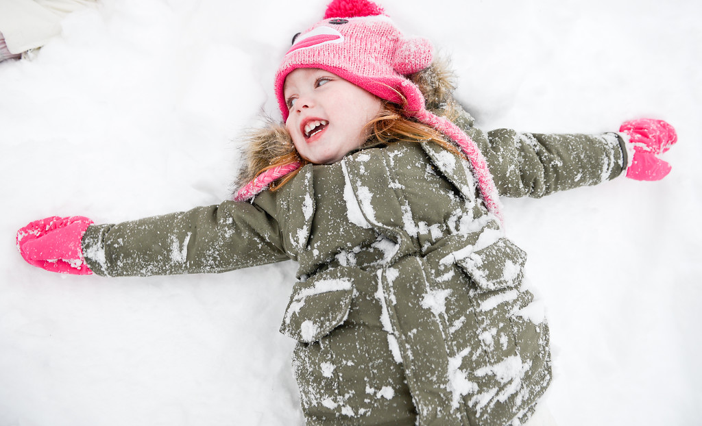 . Ameila age 2, enjoys making snow angels on January 27, 2015 in Stony Brook, New York. Snow levels from winter storm Juno in New York have ranged from 7.8 inches in Central Park to more than 28 inches in Eastern Long Island. (Photo by Andrew Theodorakis/Getty Images)