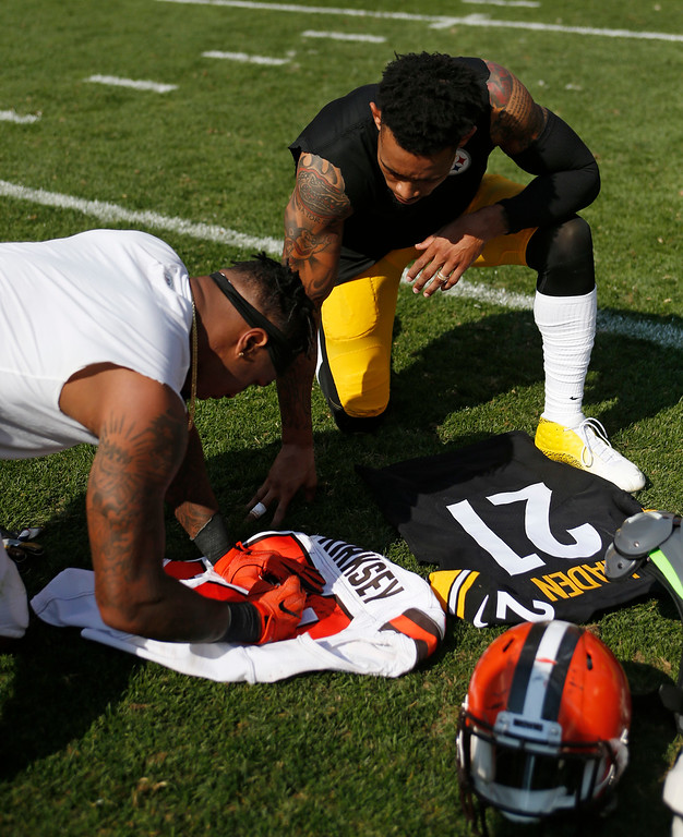 . Cleveland Browns inside linebacker Christian Kirksey, left, signs his jersey before trading with Pittsburgh Steelers cornerback Joe Haden after an NFL football game, Sunday, Sept. 10, 2017, in Cleveland. (AP Photo/Ron Schwane)