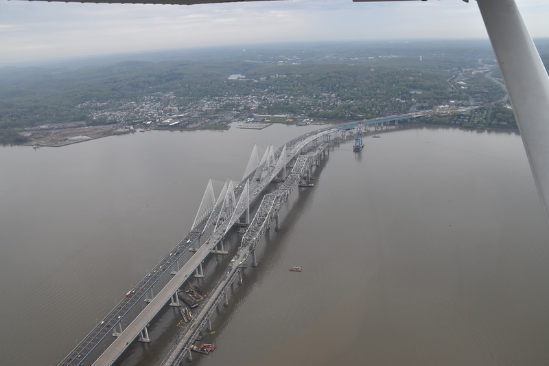 Passing over the Tappen Zee bridge, being dismantled, while one span of the newly completed Mario Cuomo Bridge carries traffic, the second span still under construction