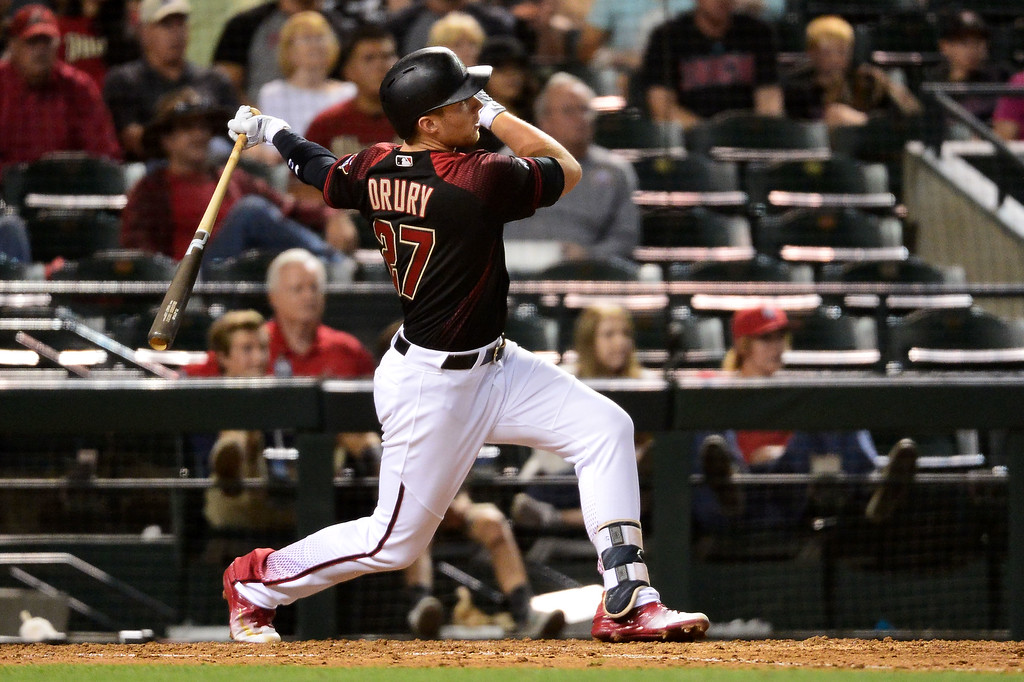 . Brandon Drury #27 of the Arizona Diamondbacks hits a two run home run against the Colorado Rockies during the sixth inning at Chase Field on April 30, 2016 in Phoenix, Arizona.  (Photo by Jennifer Stewart/Getty Images)
