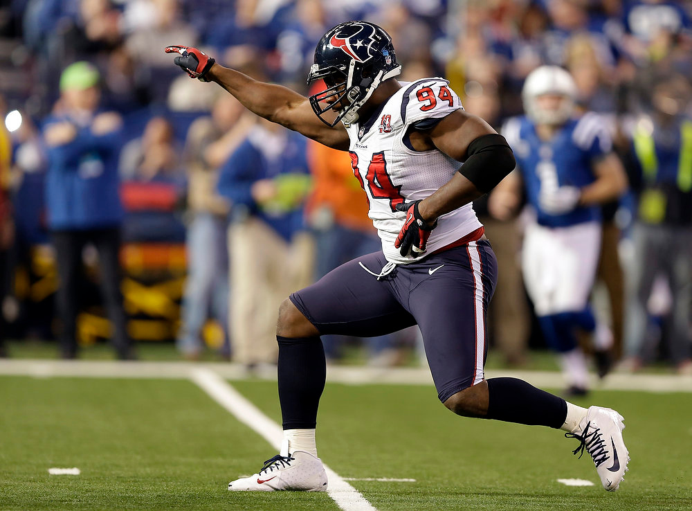 . Houston Texans\' Antonio Smith (94) reacts following a play during the first half of an NFL football game against the Indianapolis Colts, Sunday, Dec. 30, 2012, in Indianapolis. (AP Photo/Michael Conroy)