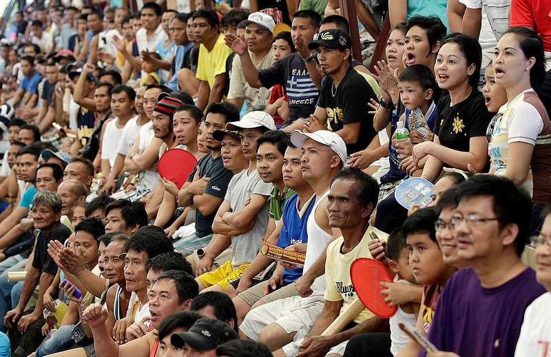 . Filipinos react after seeing Filipino boxing hero Manny Pacquiao was knocked out by Mexican Juan Manual Marquez during a live TV broadcast at a multi-purpose hall in suburban Paranaque, south of Manila, Philippines on Sunday, Dec. 9, 2012. Many Filipinos were stunned by Pacquiaoís knockout defeat to Marquez, dampening the spirit of a nation battered recently by a powerful typhoon. (AP Photo/Aaron Favila)