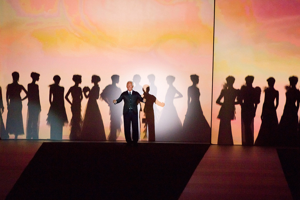 """. Giorgio Armani takes a bow at the conclusion of his \""""One Night Only New Yorkî fashion show on Thursday, Oct. 24, 2013 in New York. (Photo by Charles Sykes/Invision/AP)"""