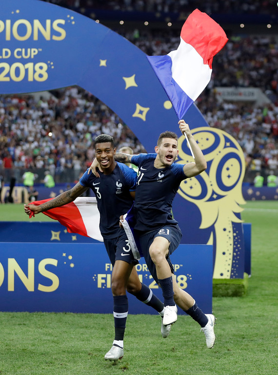 . France\'s Presnel Kimpembe and Lucas Hernandez celebrate after the final match between France and Croatia at the 2018 soccer World Cup in the Luzhniki Stadium in Moscow, Russia, Sunday, July 15, 2018. France won the final 4-2. (AP Photo/Matthias Schrader)