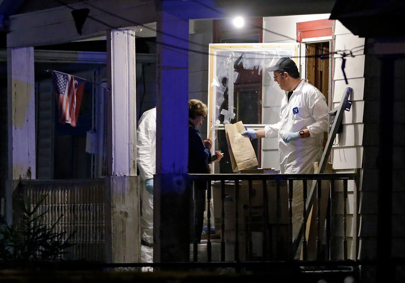 . Members of the FBI evidence team remove items from a house on in Cleveland Monday, May 6, 2013. Three women who went missing separately about a decade ago, when they were in their teens or early 20s, were found alive in the house, and a man was arrested. (AP Photo/Mark Duncan)