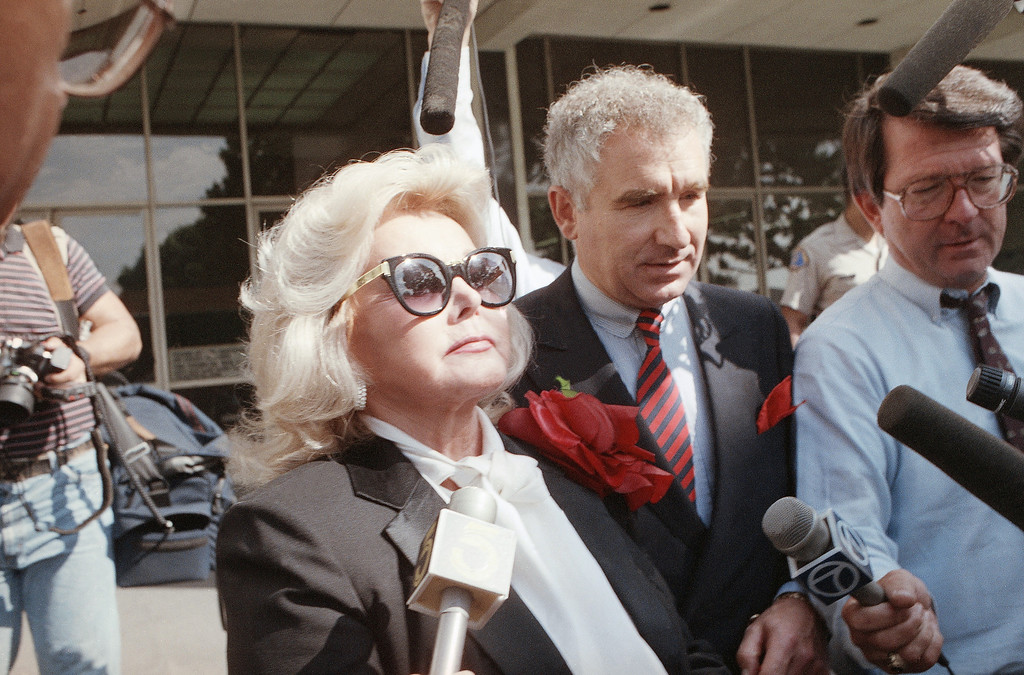 . Zsa Zsa Gabor walks down the steps of the Beverly Hills, Calif., courthouse after she left her cop-slapping trial in tears on Sept. 27, 1989.     (AP Photo/Kevork Djansezian)