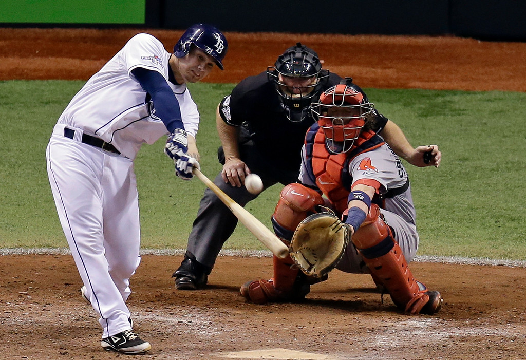 . Tampa Bay Rays\' Jose Lobaton hits a home run in front of Boston Red Sox catcher Jarrod Saltalamacchia in the ninth inning to win Game 3 of an American League baseball division series in St. Petersburg, Fla., Monday, Oct. 7, 2013. Tampa Bay Rays won 5-4. (AP Photo/John Raoux)