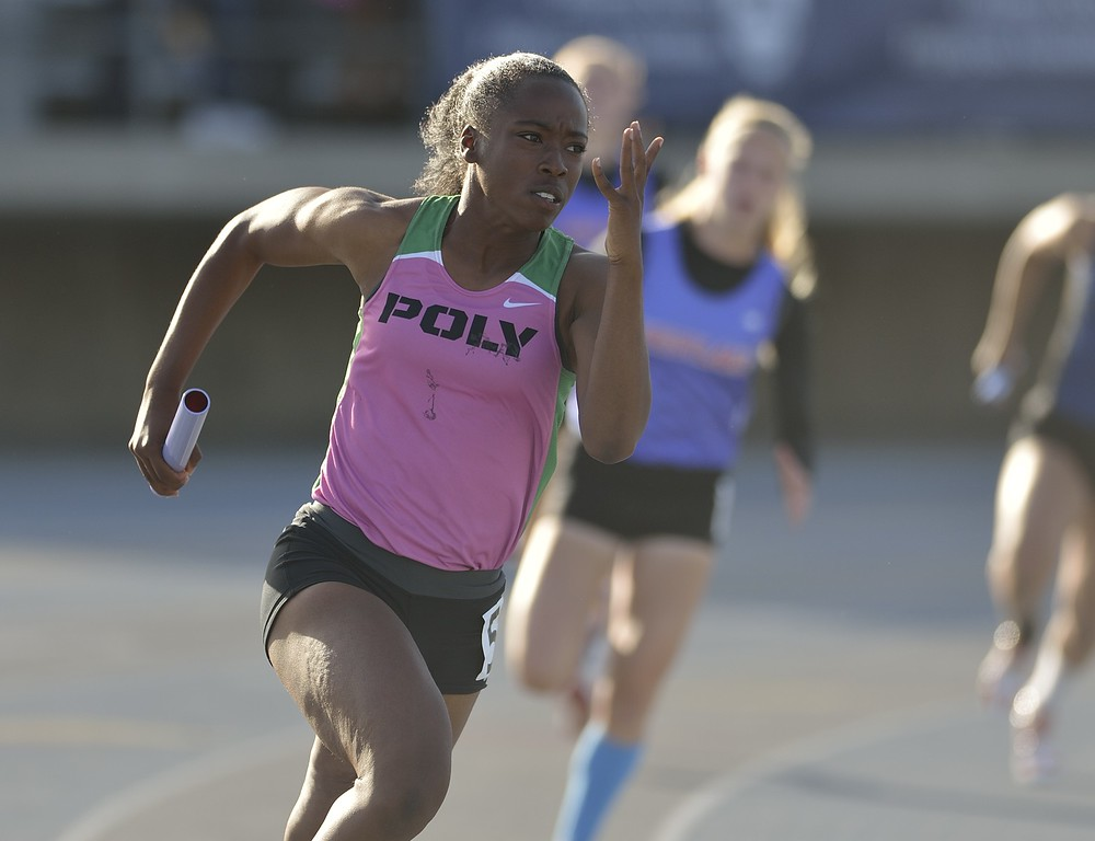 . NORWALK, CALIF. USA -- Poly\'s Maya Perkins competes in the 4x100 relay during the CIF-SS Masters Track and Field Meet in Norwalk, Calif., on Friday, May 24, 2013. Photo by Jeff Gritchen / Los Angeles Newspaper Group