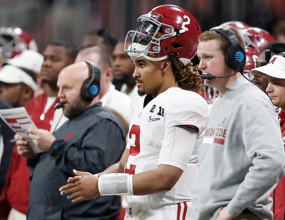 . Alabama quarterback Jalen Hurts watches from the bench during the second half of the NCAA college football playoff championship game against Georgia Monday, Jan. 8, 2018, in Atlanta. (AP Photo/David Goldman)
