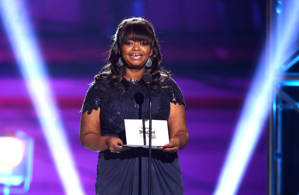 Description of . Octavia Spencer presents an award at the 18th Annual Critics' Choice Movie Awards at the Barker Hangar on Thursday, Jan. 10, 2013, in Santa Monica, Calif.  (Photo by Matt Sayles/Invision/AP)